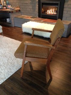 Refurbished teak arm chair from the Thrift store