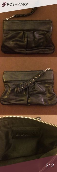 Black Faux leather Express Wristlet Black Wristlet with a zippered top and studded grommets on handle. Express Bags Clutches & Wristlets