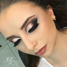 Dramatic pink and black smokey eye.