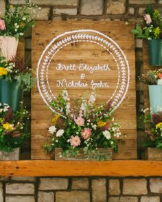 This couple crafted a blooming display out of stained pine planks and galvanized buckets painted in an array of colors