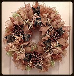 This is a great wreath to hang in a cabin or any western décor.    This wreath is made from burlap, brown and moss green deco mesh.    There are
