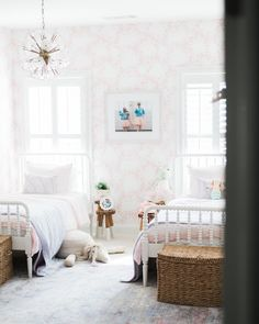 Twin beds in a airy pink and natural tolnes toddler girl's space. Photo by meghan basinger in Milton, Georgia with @aleamoore.