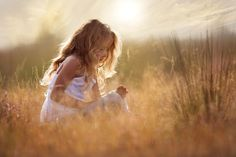 """""""Little Maartje sunset"""" - Little Maartje is playing in the grass."""