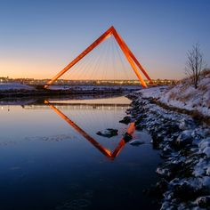 A pair of hollow red pyramids support the weight of these bridges that span the mouth of the river Elliðaár in the Icelandic capital (+ slideshow).