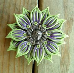 Handmade Flower Button, hand sculpted, green and purple, made from polymer clay by ZudaGay