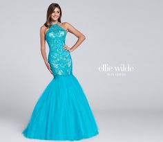 Ellie Wilde EW117120 - Sleeveless tulle mermaid gown with high halter neckline, lace and heat-set stone bodice, dropped waist, full skirt.