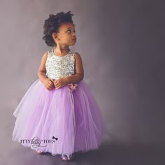 Silver sequin and purple tulle dress. A perfectly purple party dress! This silver sequin girls party dress is Offered by Baby Boutique - Itty Bitty Toes!