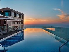 The rooftop infinity pool at Tel-Aviv's The Setai hotel has the best sunset views overlooking the Mediterranean in all of Israel. Beach Hotels, Hotels And Resorts, Mykonos, Bauhaus, Prison, Piscina Hotel, Tel Aviv Hotels, Tel Aviv Beach, Spa Treatment Room