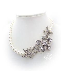 Wedding Necklace Swarovski Pearl & Crystal Rhinestone Bridal Necklace Wedding Jewelry. Very pretty but it may be a little much with the flowers, I would have to see what it looked like