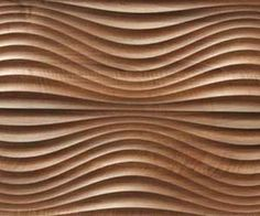 Interlam's Art Diffusion collection features homogeneously colored or raw MDF panels whose surfaces have been sculpted and carved into dramatic organic forms through the use of CNC routers.
