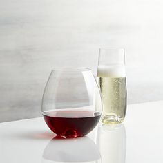 Contemporary stemless glasses cradle perfectly in hand. The stemless wine features a rounded shape and wide opening to allow wines to breathe and reveal their unique aromatics and flavors. The champagne flute's iconic shape goes stemless for aroma-enhanced and bubble-promoting sipping. Created exclusively for us at Rona, the oldest existing Slovakian glass factory founded in 1892, each glass is fire polished for smoothness and accented with a small, hollow dome at its base.