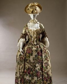 Robe and petticoat  Place of origin:  England, Great Britain (made)   Spitalfields, England (woven)  Date:  1765-1770 (made)   1735-1739 (woven)  Materials and Techniques:  [Stomacher] Brocaded silk, silk thread, silk fringe, hand-woven, hand-braided and hand-sewn   [Petticoat] Plain and brocaded silk, silk thread, silk fringe, hand-woven, hand braided and hand-sewn