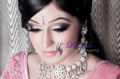 Indian bridal make-up and hair. A smokey look with subtle pink check out more of PurpleHazeArtistry at culturalweddings.com /beauty