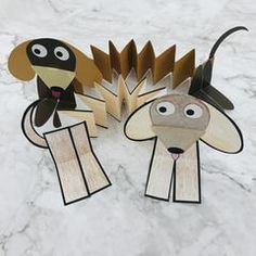 DIY Tutorial for Kids: Paper Slinky Dog Craft Template | The Pet Gourmet® Dog Template, Templates, Camping Activities For Kids, Dog Crafts, Book Week, Diy Tutorial, Make Your Own, Art For Kids, Pets