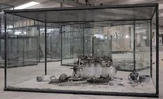 Anselm Kiefer, Flying Fortress, airplane engine, steel, photographs, lead and oil, emulsion, acrylic, shellac on clay on canvas in inscribed glass and steel vitrine, 2010.