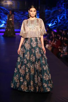 Teal green lehenga by Manish Malhotra on thedelhibride.com  Outfit details: Teal Green Lehenga Skirt with Gold Mushroom Flower Motifs & Metallic Silver Gold Cape crop top - Manish Malhotra - Amazon India Couture Week 2015