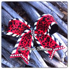 Cheer Bow Red leopard black white with Bling on Etsy or Facebook by Two Tiara's Bowtique