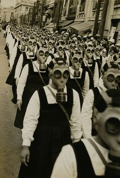Girls Drill for Poison Gas Attack: Gas-Mask Parade in Tokyo, by Masao Horino 1936-1939 (KO)