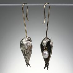A pair of Gabriella Kiss sterling silver sleeping birds with a small white pearl earrings @quadrum