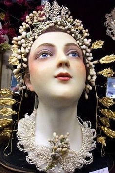 fab old mannequin with blue eyes - millinery embellished.