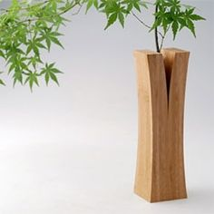 """""""Split wood"""" vases from the Laminated Bamboo Lumber Project by Japanese design collective Teori. Yum."""