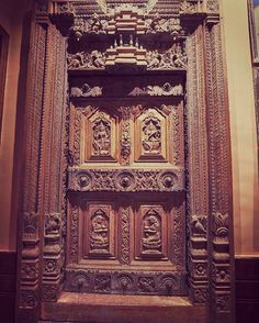 Carved with magnificent artistic precision this Chettinad door at our new JADE Flagship is an excellent exhibit of the hand-sculpted doors found in South India. It is believed that the bigger the door the more sacred and pious the area it leads to House Main Door Design, Pooja Room Door Design, Wooden Door Hangers, Wooden Doors, Indian Main Door Designs, Indian Doors, Rangoli Designs Flower, Traditional Doors, Pooja Rooms