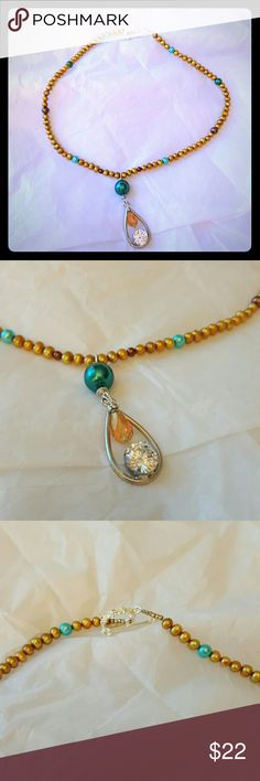 "Sunshine Necklace Handmade necklace features golden potato pearls, glass pearls accents, crystal teardrop, sterling silver accent beads, toggle clasp and a gorgeous and dazzling CZ focal piece.   This necklace is 20"" in length not including the focal piece. Jewelry Necklaces"