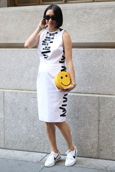 NYFW Street Style Day 4: Eva Chen outfitted her bump with a smile.
