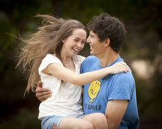 A fun and carefree couples photography shoot sets inhibitions free.