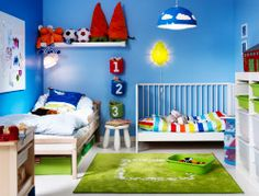 A shared IKEA bedroom with a crib, child's bed and storage