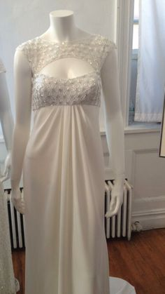 Love the geometric motif on the neckline of this David's Bridal gown