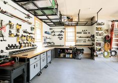 Storage and Organization in the Garage - Chris Loves Julia Garage Design, House Design, Overhead Storage Rack, Chris Loves Julia, Carport Garage, Ceiling Storage, Tall Ceilings, Hobby Room, Base Cabinets