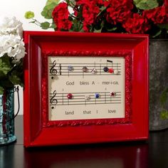"""God Bless America"" sheet music picture with fabric-covered buttons in RW&B for notes 