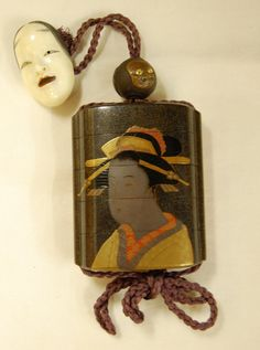 Netsuke. In the form of a Noh mask. ~ Inro (4 case). Actor as geisha. Made of lacquered wood (red, gold). Made by: Sukeyasu