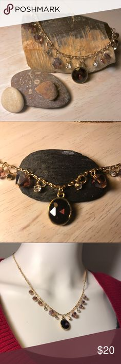 🆕 Purple Stone Gold Statement Fashion Necklace This is gold chained necklace with purple gem stones. You're sure to make a statement when you wear this!  This is new, but was removed for pictures. Price reflects a display model discount.  LAST ONE LEFT!  The main piece is about 5 inches in size and the chain is 18 inches long.   Thank you for looking and feel free to ask any questions! 😊 Jewelry Necklaces