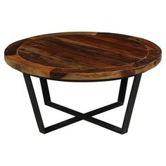 Showcasing a wood top and round silhouette, this classic coffee table is perfect anchoring a bold rug in your living room or den.  P...
