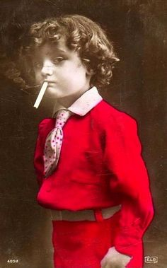 The Smoker - Hand Tinted Postcard - Well dressed young boy smoking a cigarette. There is nothing to identify this juvenile delinquent ...