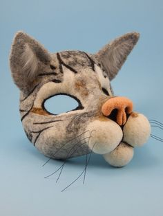 """A needle felted cat mask from the book """"Needle Felting Masks and Finger Puppets"""" by Terese Cato"""