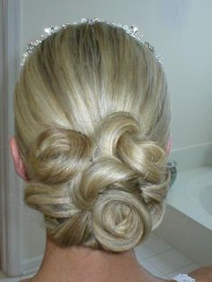 wedding hair that's low in back - but still up.  Beautiful big pinned curls