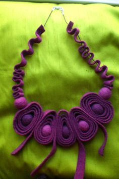 Necklace realised in shade of purple felt