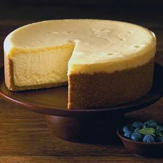 The Cheesecake Factory Original Cheesecake. Owen made. Very good, but look at comments for alternative temp. No convecrion, top got too brown.