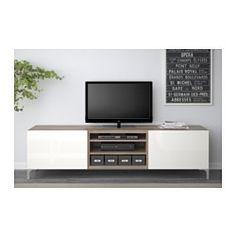 IKEA - BESTÅ, Tv-meubel met lades, zwartbruin/Selsviken hoogglans/beige, laderail, druk-en-open, , De lades hebben een geïntegreerde druk-en-openfunctie, waardoor je geen handgreep of knop nodig hebt en de lade met een lichte druk kan openen.Alle snoeren van de tv en andere apparatuur zijn eenvoudig uit het zicht, maar binnen handbereik te houden, omdat er aan de achterkant van het tv-meubel meerdere snoeropeningen zitten.Door de uitsparing aan de bovenkant kan je snoeren gemakkelij...