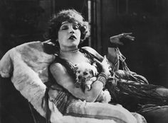 0 Mae Murray with dog in her arms Mae Murray, Silent Film Stars, Pup, Weird, Pure Products, Statue, History, Painting, Hollywood Actresses
