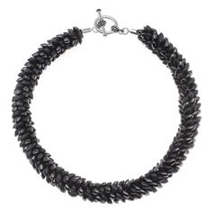 This necklace is both dramatic and fierce! Shiny and matte gunmetal colored Miyuki Long Magatama beads have been Kumihimo braided into a spiral pattern that is visually stunning and texturally intriguing.