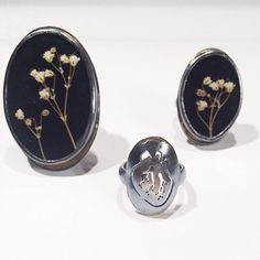 Sweet collection of rings by Luana Coonen. 18k, 14k, sterling silver, acrylic, polycarbonate, baby's breath