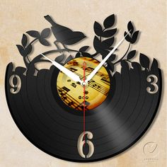 vinyl wall clock  garden bird by Anantalo on Etsy, ฿1100.00                                                                                                                                                      Más
