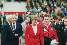 Princess Diana at a rugby match in a red black buttoned suit 1991...