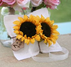 Summer Sunflower Burlap Ring Bearer Pillow With Engraved Personalized Wood Heart Charm. $39.99, via Etsy.