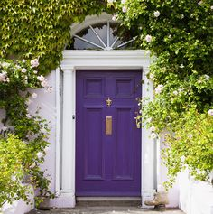 A lilac front door is believed to convey a creative homeowner.