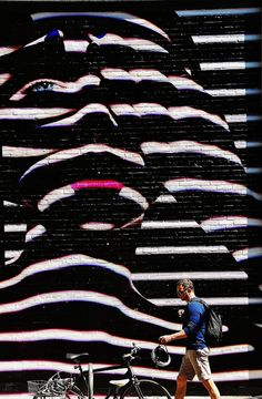 "I LOVE THIS MURAL painted on a brick wall!!!  Tim Schreier's photos on Flickr is called ""Behind BLue Eyes"", taken May 6, 2012 in Soho NYC"
